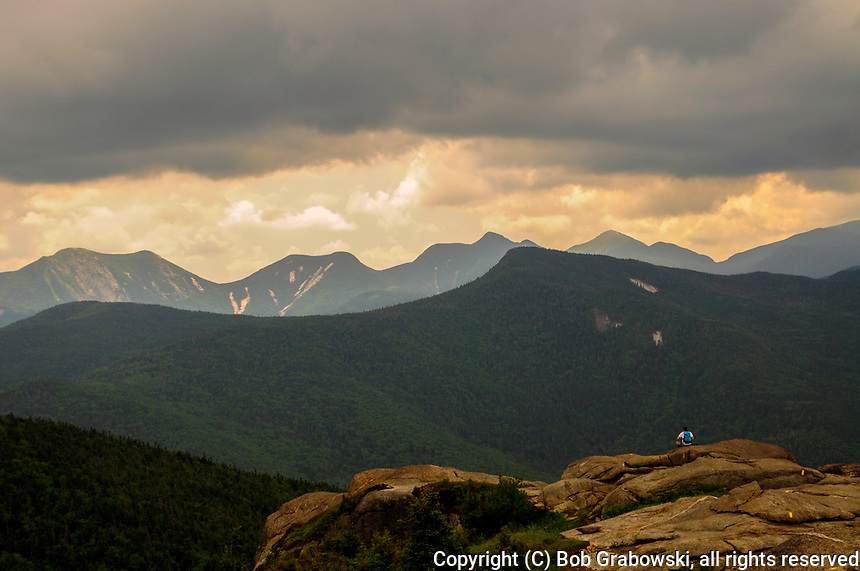 Hiker Enjoying The View From The Top Of Cascade Mountain In The Adirondack Moutains Of New York State