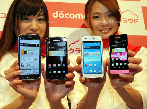 May 16, 2012, Tokyo, Japan - Models show a new lineup of NTT Docomos smartphones during a launch in Tokyo on Wednesday, May 16, 2012. Japans largest telephone company released the array of 16 smartphones, of which 11 models are compatible with its Xi LTE service for extra-fast access and navigation. (Photo by Natsuki Sakai/AFLO) AYF -mis-