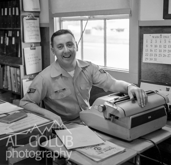 Director of information office clerk A/1C Larry Bruno <br /> <br /> March 1964: CAFB, California<br /> Staff of the Valley Bomber, 93rd Bomb Wing, Directory of Information, SAC<br /> Photo by Al Golub/Golub Photography <br /> <br /> Castle is named for Brigadier General Frederick W. Castle, who died on Dec. 24, 1944 flying his 30th bombing mission. He died leading an armada of 2000 B-17s on a strike against German airfields. On the way to the target, an engine failure over Liege, Belgium caused his bomber to fall behind, where it was attacked by Germans and caught fire. He ordered his men to bail out but stayed alone at the controls of the flaming Flying Fortress until it crashed. The entire crew, except Gen. Castle and one airman killed before the bailout order, survived. Gen. Castle received a Medal of Honor posthumously for his bravery.<br /> <br /> Castle became home to the 93rd Bombardment Wing in 1947. Aircraft stationed at Castle included B-29, B-17 and C-54 aircraft, with B-50 bombers arriving in 1949. In 1954, B-47 bombers arrived.  On June 29, 1955, Castle received the Air Force's first B-52. These heavy bombers can hold the equivalent of three railroad cars' worth of fuel. The first Air Force KC-135 jet tanker arrived May 18, 1957<br /> <br /> Castle was selected for closure under the Defense Base Closure and Realignment Act of 1990 during Round II Base Closure Commission deliberations (BRAC 91). The last of the B-52s left the base in 1994, followed by the departure of the last of the KC-135s in early 1995. The base closed September 30, 1995.