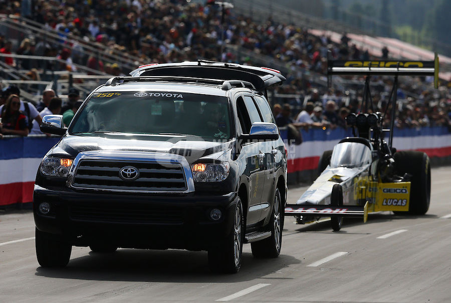 Feb 7, 2014; Pomona, CA, USA; The Toyota tow vehicle for NHRA top fuel dragster driver Richie Crampton on the return road in front of the crowd during qualifying for the Winternationals at Auto Club Raceway at Pomona. Mandatory Credit: Mark J. Rebilas-