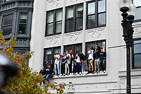 October 31, 2018: Fans stand on window ledges during the Boston Red Sox 2018 World Series championship celebration parade held in Boston, Mass.  Eric Canha/CSM