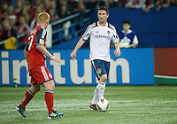 07 March 2012: LA Galaxy forward Robbie Keane #7and Toronto FC defender Richard Eckersley #27 in action during a CONCACAF Champions League game between the LA Galaxy and Toronto FC at the Rogers Centre in Toronto.