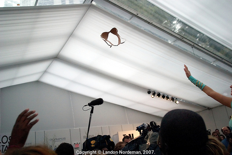 "NEW YORK--SEP 8 A ""Barely There"" tag free bra is thrown into the crowd at Bryant Park during Olympus Fashion Week Spring 2005 in New York City on September 8, 2004. (Photo by Landon Nordeman/Getty Images)"