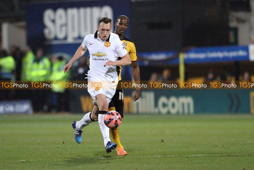 Phil Jones of Manchester United runs with the ball - Cambridge United vs Manchester United - FA Challenge Cup 4th Round Football at the R Costings Abbey Stadium, Cambridge - 23/01/15 - MANDATORY CREDIT: Mick Kearns/TGSPHOTO - Self billing applies where appropriate - contact@tgsphoto.co.uk - NO UNPAID USE