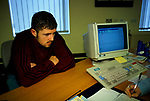 Job Centre young man out of work looking for a work being interviewed. 1998 1990s  Mountain Ash Wales UK