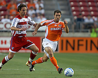 Houston Dynamo's Brian Mullan (9) dribbles away from FC Dallas'  Mark Wilson (15) at Robertson Stadium in Houston, TX on Saturday May 6, 2006. The Houston Dynamo defeated FC Dallas 4-3.