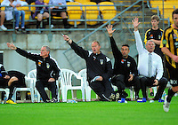 The Phoenix coaching staff, from left,Russell Gray, Jonathan Gould, Luciano Trani and Ricki Herbert make a point from the bench. A-League football - Wellington Phoenix v Newcastle Jets at Westpac Stadium, Wellington on Saturday, 18 December 2010. Photo: Dave Lintott / lintottphoto.co.nz