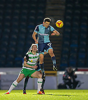 Myles Weston of Wycombe Wanderers wins the ball as Tom Eaves of Yeovil Town looks on during the Sky Bet League 2 match between Wycombe Wanderers and Yeovil Town at Adams Park, High Wycombe, England on 14 January 2017. Photo by Andy Rowland / PRiME Media Images.