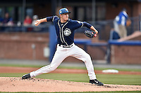 Asheville Tourists starting pitcher Ryan Castellani (6) delivers a pitch during game one of a double header against the Greenville Drive on April 18, 2015 in Asheville, North Carolina. The Tourists defeated the Drive 2-1. (Tony Farlow/Four Seam Images)