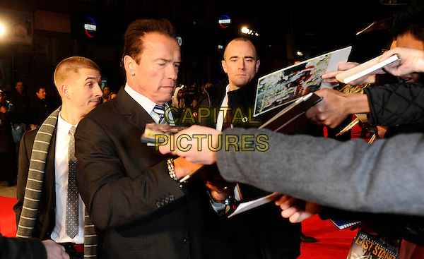 Arnold Schwarzenegger.'The Last Stand' UK film premiere at Odeon West End cinema, Leicester Square, London, England..22nd January 2013.half length grey gray suit shirt white shirt blue tie signing autographs crowd fans.CAP/DH.©David Hitchens/Capital Pictures