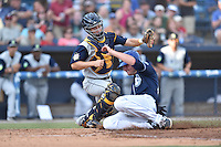 Columbia Fireflies catcher Pat Mazeika (2) attempts to tag Sam Hilliard (25) as he slides in safely during a game against the Asheville Tourists at McCormick Field on June 18, 2016 in Asheville, North Carolina. The Tourists defeated the Fireflies 5-4. (Tony Farlow/Four Seam Images)