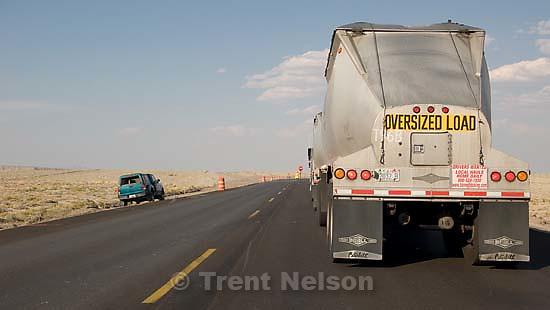 flagman, semi trucks, oversized load, driving north to huntington