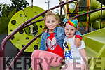 Lucy and Holly Murphy delighted to be back playing in the playground in Milltown