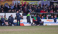 Newport County manager Warren Feeney (left, standing) and Accrington Stanley manager John Coleman (seated right in tie) during the Sky Bet League 2 match between Newport County and Accrington Stanley at Rodney Parade, Newport, Wales on 28 March 2016. Photo by Mark  Hawkins.