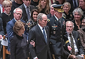 Former United States President George W. Bush, center, and former first lady Laura Bush, escorted by Major General Michael L. Howard, Commanding General, Joint Force Headquarters-National Capital Region, arrive for the National funeral service in honor of the late former United States President George H.W. Bush at the Washington National Cathedral in Washington, DC on Wednesday, December 5, 2018.<br /> Credit: Ron Sachs / CNP<br /> (RESTRICTION: NO New York or New Jersey Newspapers or newspapers within a 75 mile radius of New York City)