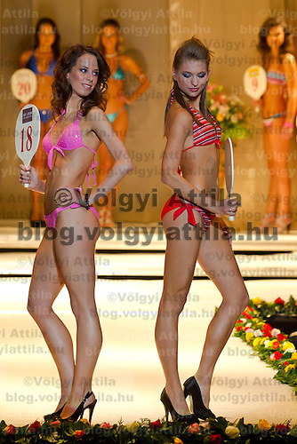 Anna Zsiros (left) and Bianka Strazsi (right) attends the Miss Hungary 2010 beauty contest held in Budapest, Hungary on November 29, 2010. ATTILA VOLGYI