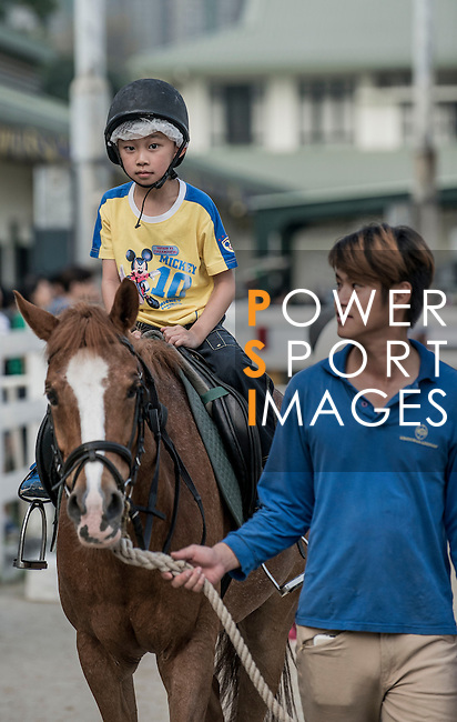 People attend The Hong Kong Jockey Club Tuen Mun Public Riding School Open Day on 12 May 2013, in Hong Kong. Photo by Andy Jones / The Power of Sport Images