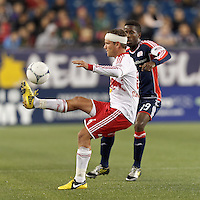 New York Red Bulls midfielder Teemu Tainio (6) flips ball over New England Revolution defender. Despite a red-card man advantage, in a Major League Soccer (MLS) match, the New England Revolution tied New York Red Bulls, 1-1, at Gillette Stadium on September 22, 2012.