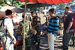 Akira, Tan & Staff In Market