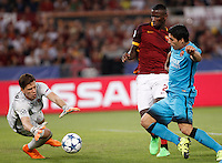 Calcio, Champions League, Gruppo E: Roma vs Barcellona. Roma, stadio Olimpico, 16 settembre 2015.<br /> Roma&rsquo;s goalkeeper Wojciech Szczesny, left, assisted by teammate Antonio Ruediger, center, grabs the ball  against FC Barcelona&rsquo;s Luis Suarez, during a Champions League, Group E football match between Roma and FC Barcelona, at Rome's Olympic stadium, 16 September 2015.<br /> UPDATE IMAGES PRESS/Isabella Bonotto
