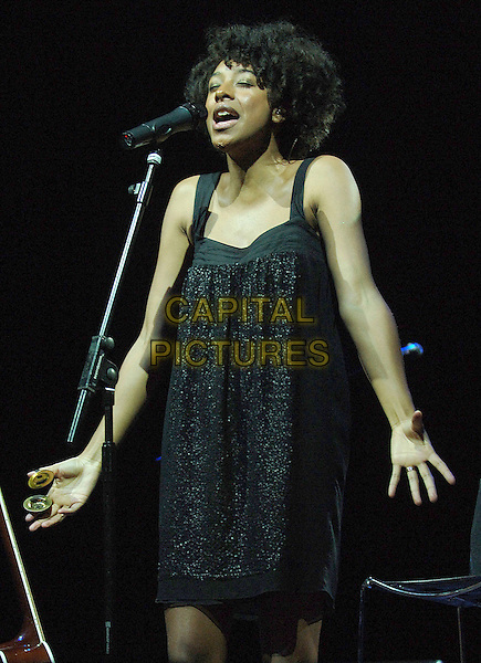 CORINNE BAILEY RAE.Performing live at the 2007 V Festival, Hylands Park, Chelmsford, England..August 19th, 2007.half length stage concert live gig performance music black dress singing microphone 3/4 cymbals .CAP/BEL.©Belcher/Capital Pictures