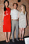 Models pose in outfits from the Oliver Green collection with designer (center), during the inaugural Wear New York Fashion Week presentation at 393 Broadway on June 27, 2013.