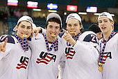 Ryan Bourque (USA - 17), Kyle Palmieri (USA - 23), Jeremy Morin (USA - 26), AJ Jenks (USA - 22) - Team USA celebrates after defeating Team Canada 6-5 (OT) to win the gold medal in the 2010 World Juniors tournament on Tuesday, January 5, 2010, at the Credit Union Centre in Saskatoon, Saskatchewan.