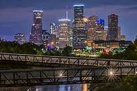 We captured Rosemont pedestrian bridge and the Houston skyline over the Buffalo Bayou at night in downtown area of the city.  Houston has a lot to offer with many parks, cultural events in the theater district, along with many sport and music event to name yet a few things to do.  Houston also has a reputation of a place to see top notched performing art along with access to several museums in the area. The Theater distric performing art has nine major performing art group along with six performance halls. You can see Opera, a plays, the ballet and any number of music events including the well known Houston Symphony Orchestra Houston has some top notch restaurants and places to stay.  Houston has a population of around 3.4 million people it the largest city in Texas and the fourth largest in the nation. The skyline of Houston is a very impressive site with some of the tallest modern skyscrapers buildings in the US. In this image you can see the Heritage Plaza, Chevron, Wells Fargo and the tallest building in Houston the J P Morgan Chase Tower at 1002 ft and it is the 17 tallest in the US. Houston is the seat of Harris county and was founded in 1837 near the banks of the Buffalo Bayou or Allen Landing as it is called today.
