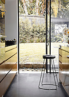 Sliding windows open from the contemporary kitchen to the garden