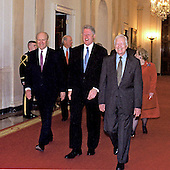 United States President Bill Clinton and former U.S. Presidents Gerald R. Ford (left) and Jimmy Carter (right) walk to the East Room at the White House on 9 May, 2000 to make statements supporting Permanent Normal Trade (PNTR) with China.<br /> Credit: Ron Sachs / CNP
