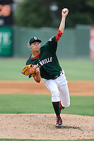 Starting pitcher Trey Ball (24) of the Greenville Drive delivers a pitch in a game against the Savannah Sand Gnats on Sunday, August 24, 2014, at Fluor Field at the West End in Greenville, South Carolina. Ball was a first-round pick of the Boston Red Sox (seventh overall) in the 2013 First-Year Player Draft. Greenville won, 8-5. (Tom Priddy/Four Seam Images)