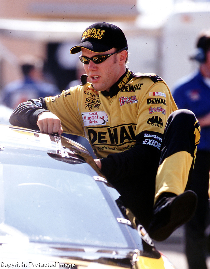 Matt Kenseth climbs into his car for a practice session at  Homestead, FL in November 2000. (Photo by Brian Cleary)
