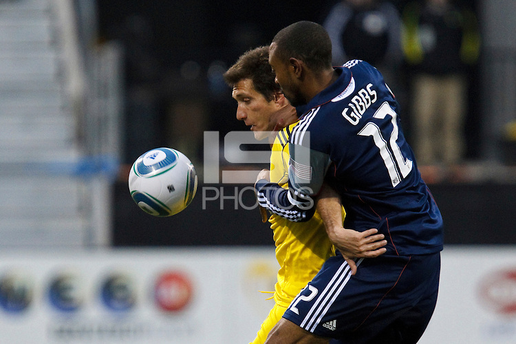 8 MAY 2010:  Guillermo Barros Schelotto of the Columbus Crew (7) and New England Revolutions' Cory Gibbs (12) during MLS soccer game between New England Revolution vs Columbus Crew at Crew Stadium in Columbus, Ohio on May 8, 2010.