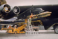Andersen Air Force Base in Guam, June 1972 - Members of US Airforce load bombs onto B-52 planes in preperation for bombing missions over Vietnam during Operation Arc Light -  Vietnam War.