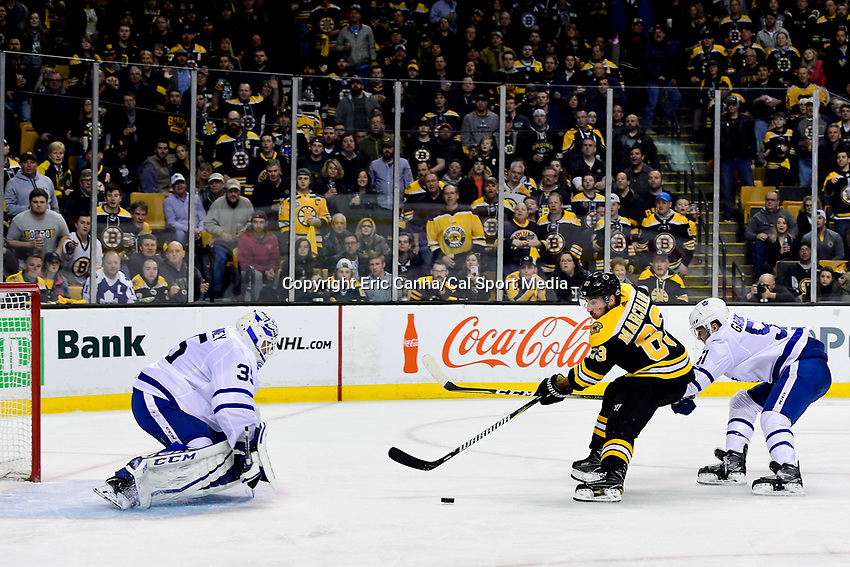 April 14, 2018: Boston Bruins left wing Brad Marchand (63) charges at Toronto Maple Leafs goaltender Curtis McElhinney (35) with the puck during game two of the first round of the National Hockey League's Eastern Conference Stanley Cup playoffs between the Toronto Maple Leafs and the Boston Bruins held at TD Garden, in Boston, Mass. Boston defeats Toronto 7-3. Eric Canha/CSM