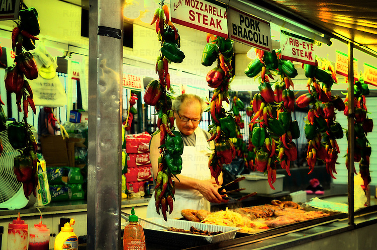 Street vendor at a market in Little Italy selling Italian specialties. Manhattan, New York City.