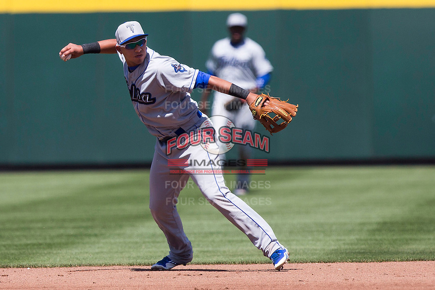 Cristhian Adames (2) of the Tulsa Drillers throws to first base during a game against the Springfield Cardinals at Hammons Field on May 4, 2014 in Springfield, Missouri. (David Welker/Four Seam Images)