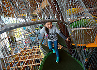 NWA Democrat-Gazette/JASON IVESTER<br /> Alejandra Carrillo, Tucker Elementary kindergartener, climbs through one of the exhibits Thursday, March 16, 2017, at the Scott Family Amazeum in Bentonville. About 100 students from the five kindergarten classes at the Rogers school were on a field trip at the museum.
