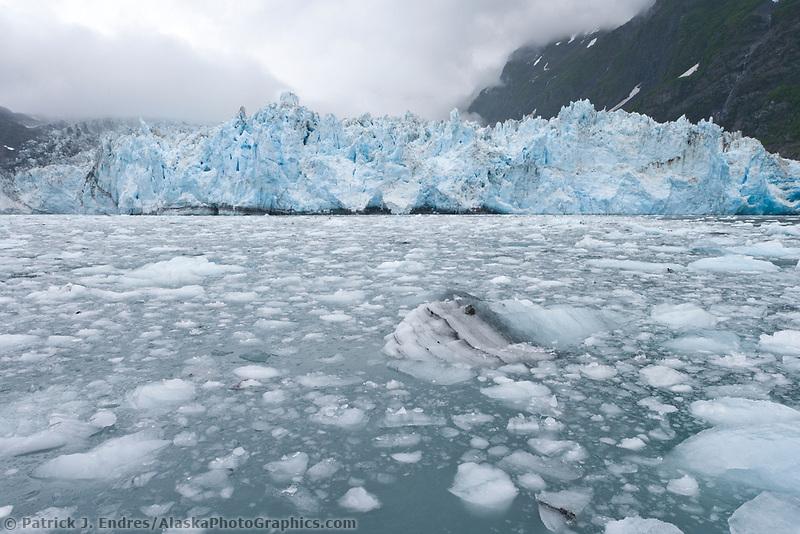 Coastal landscape of clouds hanging over the Surprise tidewater glacier in Harriman Fjord, Prince William Sound, Alaska