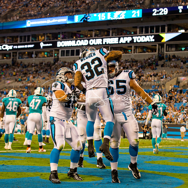 Carolina Panther's Quarterback Cam Newton is illuminated in a fiery introduction prior to the start of their preseason NFL game v. the Miami Dolphins at Bank of America Stadium in Charlotte, North Carolina.<br /> <br /> Charlotte Photographer: PatrickSchneiderPhoto.com