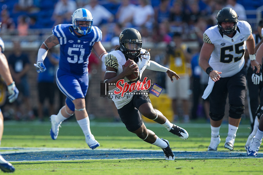 Kendall Hinton (2) of the Wake Forest Demon Deacons looks for running room during first half action against the Duke Blue Devils at Wallace Wade Stadium on September 10, 2016 in Raleigh, North Carolina.  (Brian Westerholt/Sports On Film)