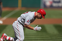 OAKLAND, CA - APRIL 1:  Mike Trout #27 of the Los Angeles Angels of Anaheim runs to first base against the Oakland Athletics during the game at the Oakland Coliseum on Sunday, April 1, 2018 in Oakland, California. (Photo by Brad Mangin)