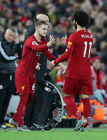 2nd January 2020; Anfield, Liverpool, Merseyside, England; English Premier League Football, Liverpool versus Sheffield United; Mohammed Salah of Liverpool  is replaced late in the second half by substitute Harvey Elliott  - Strictly Editorial Use Only. No use with unauthorized audio, video, data, fixture lists, club/league logos or 'live' services. Online in-match use limited to 120 images, no video emulation. No use in betting, games or single club/league/player publications
