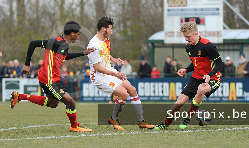20160316 - Merchtem , BELGIUM : Belgian Mike Trésor Ndayishimiye  (L) and Sebastiaan Bornauw (R) with Spanish Abel Riuz (M) pictured during the soccer match between the under 17 teams of  Belgium and Spain , on the third and last matchday in group 8 of the UEFA Under17 Elite rounds at FC Merchtem 2000 stadion in Merchtem , Belgium. Wednesday 16 th March 2016 . PHOTO DAVID CATRY
