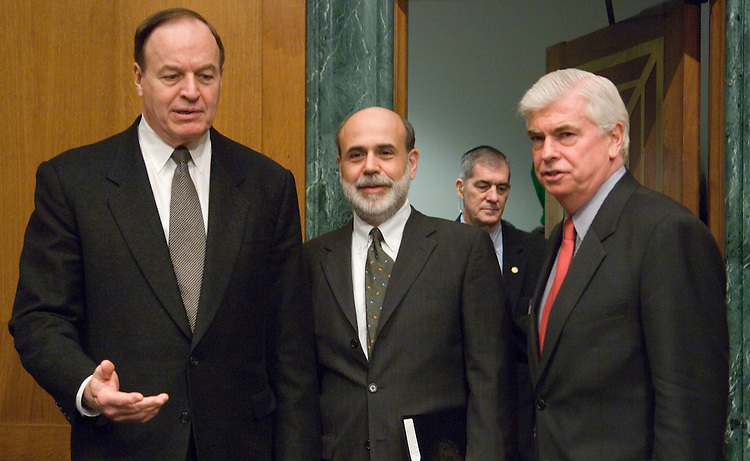 Sen. Richard Shelby, R-Ala., Federal Reserve Chairman Ben Bernanke and committee chairman Chris Dodd, D-Conn., arrive for the Senate Banking, Housing and Urban Affairs Committee hearing on the semiannual monetary policy report on Wednesday, Feb. 14, 2007.