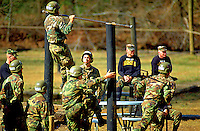 Ranger students in comouflage uniforms at pull-up bar exercise during physical training. Dahlonega, Georgia.