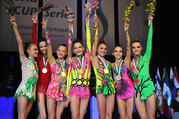 Junior team winners from (L-R) are Belarus, Russia  (Valeria Tkachenko, Alexandra Merkulova) and Germany wave flowers during medals ceremony at 2010 World Cup at Portimao, Portugal on March 12, 2010.  (Photo by Tom Theobald).
