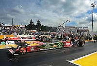 Aug. 7, 2011; Kent, WA, USA; NHRA top fuel dragster driver Terry McMillen (near lane) races alongside David Grubnic during the Northwest Nationals at Pacific Raceways. Mandatory Credit: Mark J. Rebilas-
