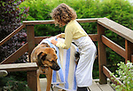 Rowland, mixed breed dog. Ellie drying dog with towel.
