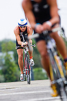 08 AUG 2010 - LONDON, GBR - Formula 1 Grand Prix driver Jenson Button checks the field ahead during the 2010 Challenger World London Triathlon age group race .(PHOTO (C) NIGEL FARROW)
